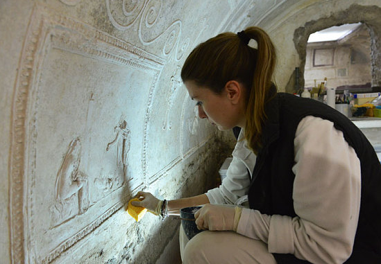 Daniela Duranti, one of the team in charge of restoring stucco figures on the walls of the pre-Christian, 1st century, underground basilica of Porta Maggiore